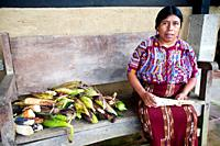 Guatemala, Mayan woman with corn harvest