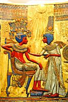 The queen ankhesenamen anointing her husband Tutankhamen beneath the life-giving rays of the sun disc, Chair Discovered in the valley of the kings , E...