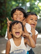Three cute Filipino brothers posing in the village of Vigan, Philippines