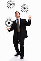 USA, Illinois, Metamora, Studio shot of businessman juggling with clocks
