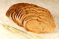 Loaf of fresh baked whole wheat bread cut into slices