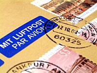 German stamps and Mit Luftpost Par Avion sticker on air mail package