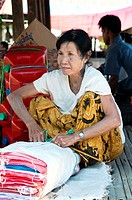 Burmese woman selling textiles at the market, Niaungshwe, Myanmar