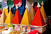 A display of pyramid shaped spices in the souq of Essaouira, Morocco