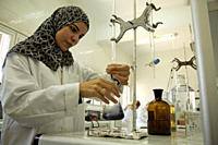 A woman tests samples of iodized salt at the laboratory of El Mex Saline Company in Alexandria This is one of the four leading salt manufacturing comp...