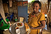 A young girl runs a restaurant cum bar, in Juba, the capital of South Sudan The income from this restaurant helps her to support her family and send h...