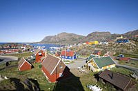 Wooden houses on the waterfront under blue sky, Sisimiut, Kitaa, Greenland