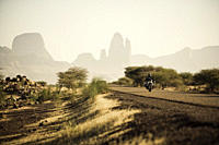 Man on motorcycle on a road in front of Hand of Fatima, Mali, Africa