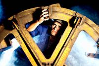 Workers repairing a large pulley on the inside of a mine when shooting with