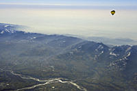 Hot_air balloon flying high above valley of Piave and Nevegal range, aerial photo, valley of Piave, Dolomites, Venetia, Italy, Europe