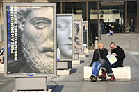 People sitting in front of the Pergamon museum, Berlin Mitte, Berlin, Germany