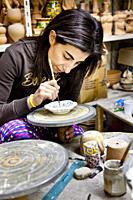 Women painting pottery, Caltegirone, Sicily, Italy