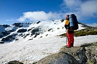 Woman practicing mountaineering in the Sierra de Béjar Natural Park, in the provincial boundary between Salamanca and Avila, Biosphere Reserve of Sier...