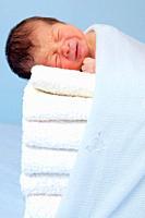New born on soft towels