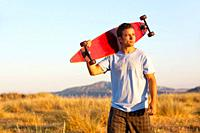 Young Male posing with his skate board