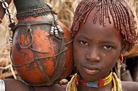Hamar girl with colorful necklaces holding a calabash, Omo river valley, Southern Ethiopia