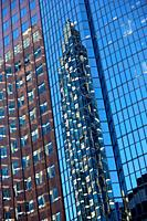 Skyscrpaers reflected in the glass windows of neighbouring skyscrapers in Montreal, Canada
