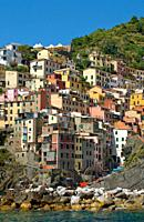 View along the coastline of the small village of Riomaggiore a popular tourist destination at the Parco Naturale Cinque Terre in the Ligurian Coast, N...