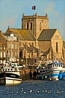 Harbour and fishing boats with houses and church in the background, Barfleur, Manche, Normandy, France, Europe