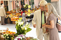 Senior couple at a market stall, Italy