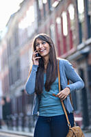 Young female on phone in street