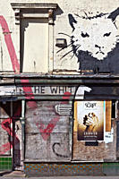 England, Merseyside, Liverpool. Run down and boarded up derelict pub covered with graffiti.
