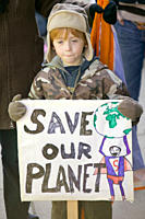 A child Protestor at the I Count climate change rally in London