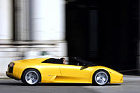 Car, Lamborghini Murcielago Roadster, Convertible, model year 2004_, yellow, open top, driving, side view, City