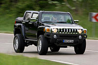Hummer H3, built by Büsching , model year 2007, driving, diagonal from the front, frontal view, country road