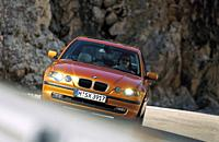 Car, BMW 3rd Compact, medium class, coupe, model year 2001_, rust_red, orange , diagonal from the front, country road, driving, ams 07/2001, Seite 030