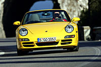 Car, Porsche 911 Carrera Convertible, model year 2005_, yellow, driving, frontal view, open top, country road, landsapprox.e, Mountains, Summer