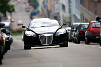 Car, Maybach Exelero Fulda, coupe/Coupe, model year 2005_, black, driving, diagonal from the front, frontal view, City