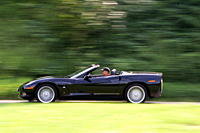 Car, Chevrolet Corvette C6 Convertible, model year 2005_, black, driving, side view, country road, open top