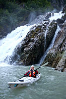 Staff member Lee Moll from the Lindblad Expeditions ship National Geographic Sea Bird kayaking in Southeast Alaska, USA No model or property releases ...