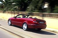 Car, Mercedes CLK 320, Convertible, model year 2003_, red, open top, driving, diagonal from the back, rear view, City