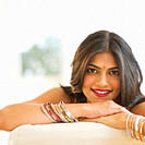 Mixed race woman wearing bindi and bangles