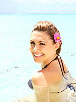 Smiling Caucasian woman swimming in ocean (thumbnail)