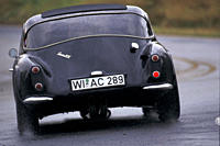 Car, TVR Griffith, model year 1963_1965, Coupé, Coupe, vintage car, 1960s, sixties, black, driving, diagonal back, back view, road, country road