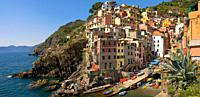 Colorful historical houses in the small coastal village Riomaggiore at the Ligurian coast, North West Italy.