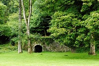 An old Lime Kiln set in woodland at Park Woods, Gower, Wales