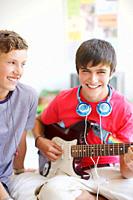 Teenage boy playing electric guitar