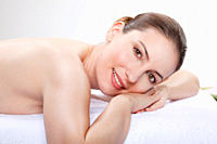 Woman having a spa treatment, smiling, portrait