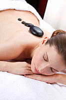 Woman with eyes closed having lastone therapy (thumbnail)