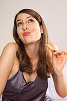 Woman looking up and enjoying asian food