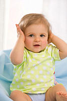 Baby girl 6_11 months hands over ears, portrait