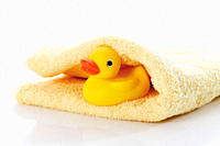 Close up of rubber duck on towel