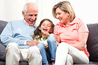 Granddaughter 6_7 and grandparents sitting and enjoying, smiling