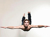 Man jumping with arms stretching, portrait