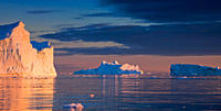 Icebergs, admitted onto UNESCO's World Heritage List, at sunset, Kangia icefjord, Disko_Bay, West_Greenland, Greenland