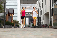 Germany, Cologne, Young women jogging